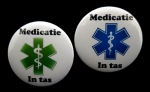 Medische button medicatie in tas of rugzak